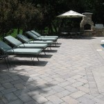 Poolscape with Lawn Chair Outdoor Kitchen