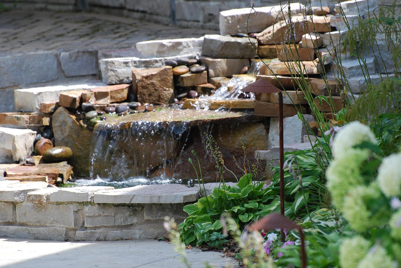 backyard waterfall in minneapolis